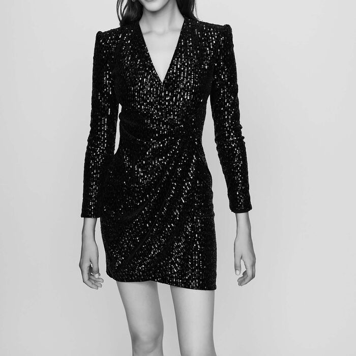 black and white photo woman wearing a glitter dress